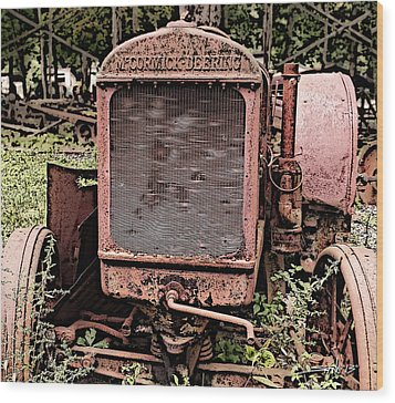 Rusted Mc Cormick-deering Tractor Wood Print by Michael Spano