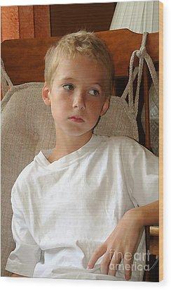 Sad Boy In Rocker Wood Print