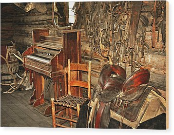 Saddle And Piano Wood Print by Marty Koch