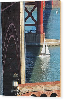 Sail Boat Passes Beneath The Golden Gate Bridge Wood Print