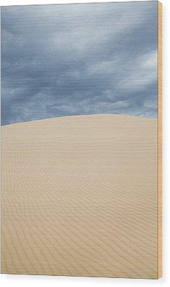 Sand Dunes And Dark Clouds Wood Print