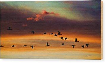 Sandhill Cranes Take The Sunset Flight Wood Print
