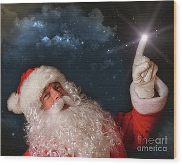 Santa Pointing With Magical Light To The Sky Wood Print