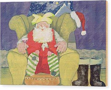 Santa Warming His Toes  Wood Print by David Cooke
