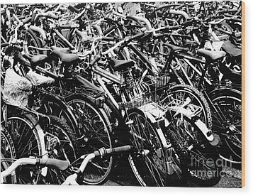 Wood Print featuring the photograph Sea Of Bicycles 2 by Joey Agbayani