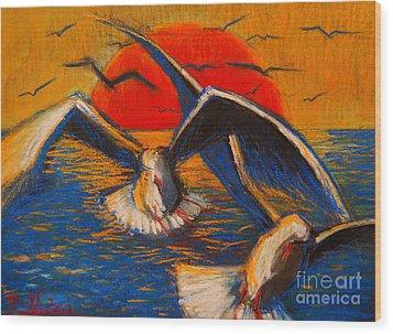 Seagulls At Sunset Wood Print by Mona Edulesco