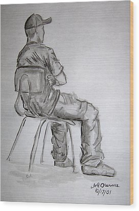 Seated Man In Ball Cap Wood Print by Jeffrey Oleniacz
