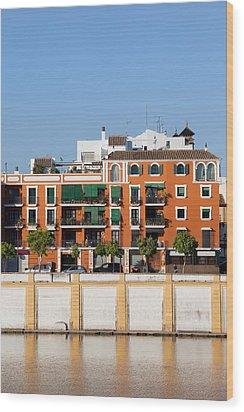 Seville House River View Wood Print by Artur Bogacki