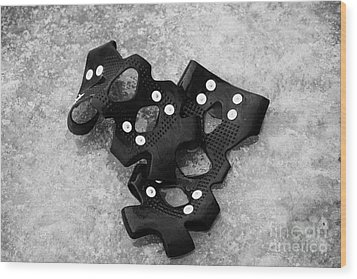Shoe Spiked Grips On Melting Ice And Snow On Street Surface Wood Print by Joe Fox