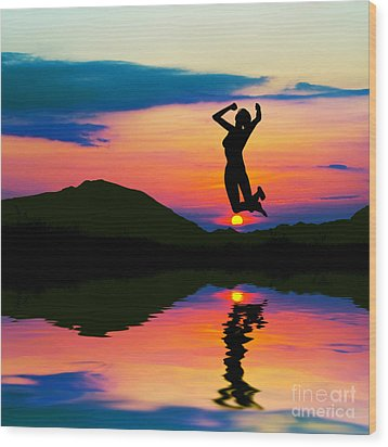 Silhouette Of Happy Woman Jumping At Sunset Wood Print