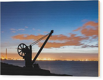 Silhouette Of The Davit In Dublin Port Wood Print by Semmick Photo