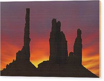 Silhouette Of Totem Pole After Sunset - Monument Valley Wood Print by Mike McGlothlen