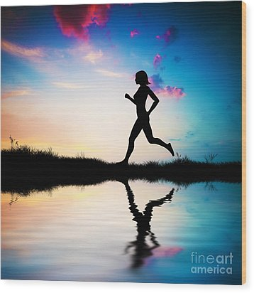 Silhouette Of Woman Running At Sunset Wood Print