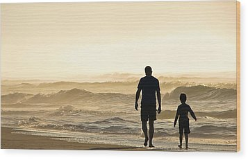 Silhouetted Father And Son Walk Beach  Wood Print