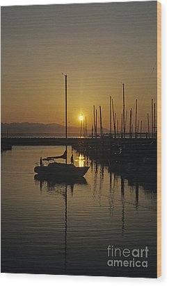 Silhouetted Man On Sailboat Wood Print