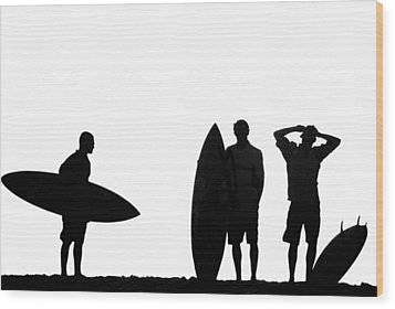 Silhouetted Surfers Wood Print by Sean Davey