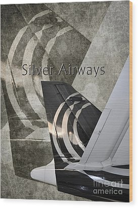Silver Airways Tail Logo Wood Print by Diane E Berry