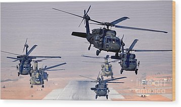 Six Uh-60l Black Hawks And Two Ch-47f Chinooks Wood Print by Paul Fearn