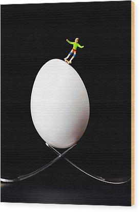 Skateboard Rolling On A Egg Wood Print by Paul Ge