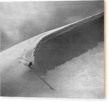 Skiing Under A Curl Wood Print by Underwood Archives