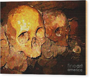 Skulls In The Paris Catacombs Wood Print by John Malone