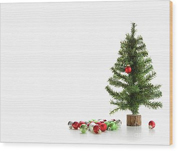 Small Artifical Tree With Ornaments On White Wood Print by Sandra Cunningham