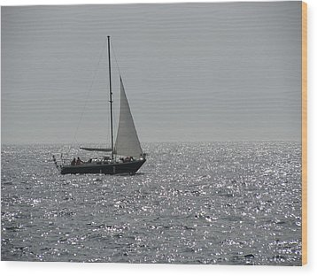 Small Boat At Sea Wood Print by Eva Csilla Horvath