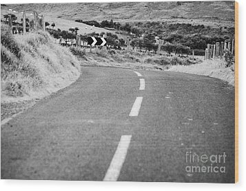 Small Narrow Country Road Leading To Dangerous Bend In County Antrim Northern Ireland Wood Print by Joe Fox