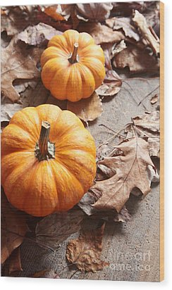 Wood Print featuring the photograph Small Pumpkins On Fall Leaves by Sandra Cunningham