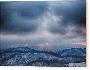 Smoky Sunset Wood Print by John Haldane