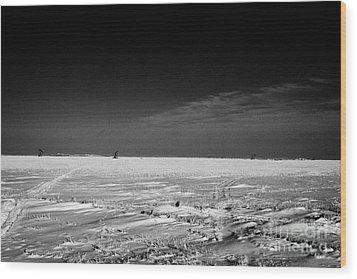 snow covered prairie agricultural farming land with pumpjacks oilfield winter Forget Saskatchewan Ca Wood Print by Joe Fox