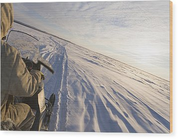 Snowmachiner Following Trail On Frozen Wood Print by Kevin Smith