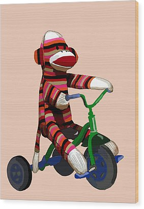Sock Monkey And Tricycle Wood Print by Kelly McLaughlan
