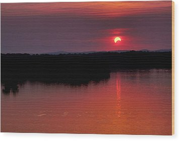 Solar Eclipse Sunset Wood Print by Jason Politte