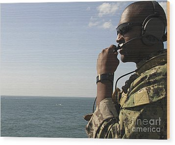Soldier Instructs Small Boat Maneuvers Wood Print by Stocktrek Images