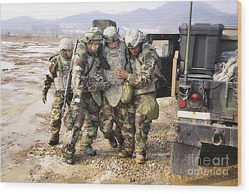 Soldiers Conduct Medical Evacuation Wood Print by Stocktrek Images
