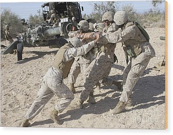 Soldiers Move The Muzzle-end Of A M777 Wood Print by Stocktrek Images