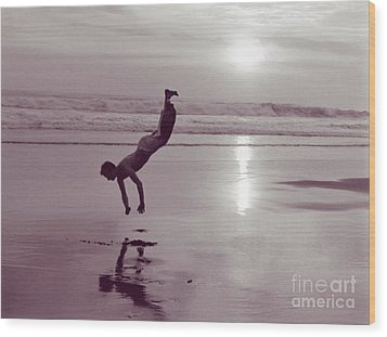 Wood Print featuring the photograph Somersalting On Bali Black Sand Beach by Mukta Gupta