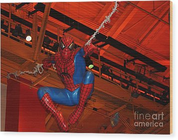 Spiderman Swinging Through The Air Wood Print