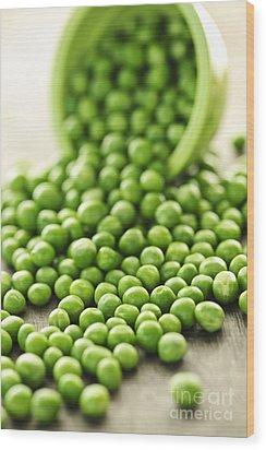 Spilled Bowl Of Green Peas Wood Print by Elena Elisseeva