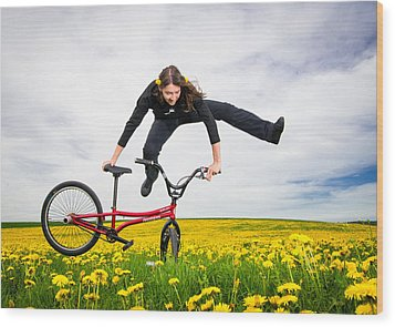 Spring Has Sprung - Bmx Flatland Artist Monika Hinz Jumping In Yellow Flower Meadow Wood Print by Matthias Hauser