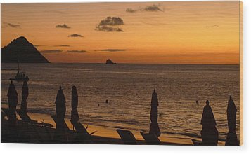 Wood Print featuring the photograph St. Lucia - Sundown - Closed Umbrellas by Nora Boghossian