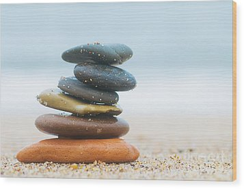 Stack Of Beach Stones On Sand Wood Print by Michal Bednarek