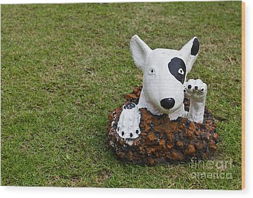 Statue Of A Dog Decorated On The Lawn Wood Print by Tosporn Preede