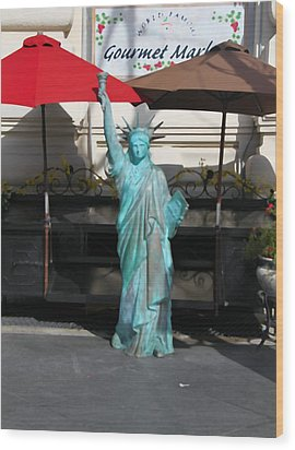 Statue Of Liberty At The Market Wood Print by Dan Sproul