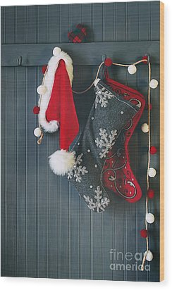 Wood Print featuring the photograph Stockings Hanging On Hooks For The Holidays by Sandra Cunningham