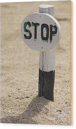 Stop Sign On Sand Wood Print by Sami Sarkis