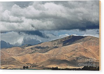 Storm Clouds Floating Above Mountains Wood Print by Susan Wiedmann