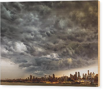 Storm Coulds Over Nyc Wood Print by Jerry Fornarotto