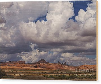 Storm Over Monument Valley Wood Print by Janice Rae Pariza